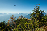 Crow flying over Eagle's Nest, Kehlsteinhaus, Hitler's lair at Berchtesgaden in the Bavarian Alps, Germany