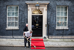 © Licensed to London News Pictures. 01/03/2017. London, UK. The red carpet is swept clean outside No 10 Downing Street before British Prime Minister Theresa May receives King Abdullah II of Jordan. Photo credit: Rob Pinney/LNP