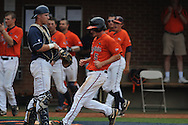 Virginia's Phil Gosselin (5) scores on a sacrifice fly in the first inning vs. Mississippi during an NCAA Regional game at Davenport Field in Charlottesville, Va. on Saturday, June 5, 2010.