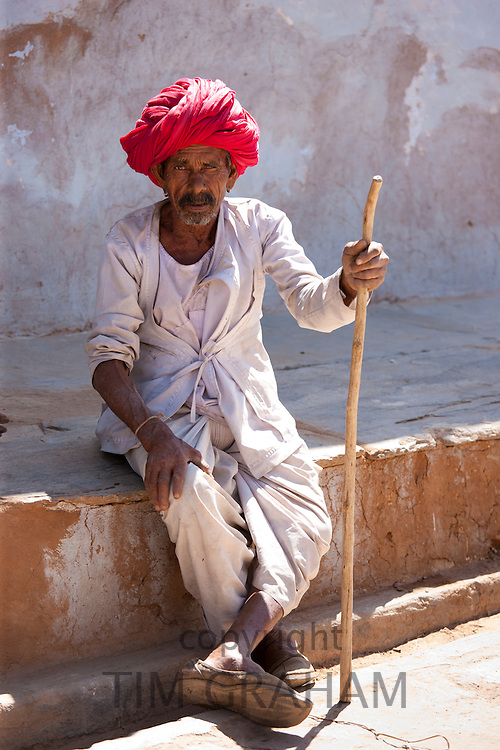 Indian man wearing traditional clothing and Rajasthani turban in village of Nimaj, Rajasthan, Northern India