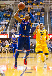 Jan 12, 2016; Morgantown, WV, USA; Kansas Jayhawks guard Devonte' Graham (4) shoots in the lane during the first half against the West Virginia Mountaineers at the WVU Coliseum. Mandatory Credit: Ben Queen-USA TODAY Sports