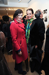 Left to right, JASMINE GUINNESS and SAFFRON ALDRIDGE at a private view of photographs by Nick Ashley held at the Sladmore Gallery, 32 Bruton Place, London on 13th January 2010.