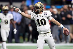 UCF Knights quarterback McKenzie Milton (10) signals for a first down during the 2018 Chick-fil-A Peach Bowl NCAA football game against the Auburn Tigers on Monday, January 1, 2018 in Atlanta. (Jason Parkhurst / Abell Images for the Chick-fil-A Peach Bowl)