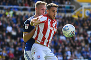 Birmingham City defender Marc Roberts (4) battles for possession with Stoke City forward Lee Gregory (19) during the EFL Sky Bet Championship match between Birmingham City and Stoke City at the Trillion Trophy Stadium, Birmingham, England on 31 August 2019.