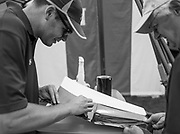 Henley-on-Thames. United Kingdom. Yale University, appling the Vinyl Decals to their oars in preparation for the 2017 Henley Royal Regatta, Henley Reach, River Thames. <br /> <br /> 10:47:40  Tuesday  27/06/2017   <br /> <br /> [Mandatory Credit. Peter SPURRIER/Intersport Images.