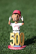 ANAHEIM, CA - MAY 21:  Closeup photo of the Bobble Head created for Albert Pujols #5 of the Los Angeles Angels of Anaheim on the grass at Angel Stadium before the game against the Houston Astros at Angel Stadium on Wednesday, May 21, 2014 in Anaheim, California. The Angels won the game 2-1. (Photo by Paul Spinelli/MLB Photos via Getty Images)