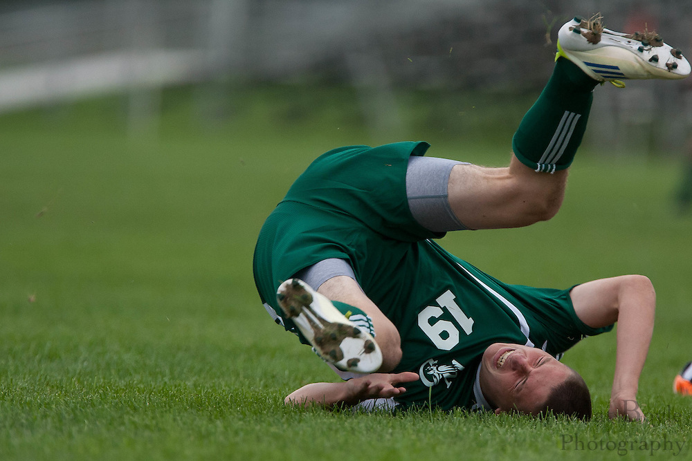 West Deptford's Hunter Holmstrom falls to the ground after getting tackled by Sterling's Ola Zaccheaus during the first match of the season at Sterling High School on Thursday September 8, 2011.