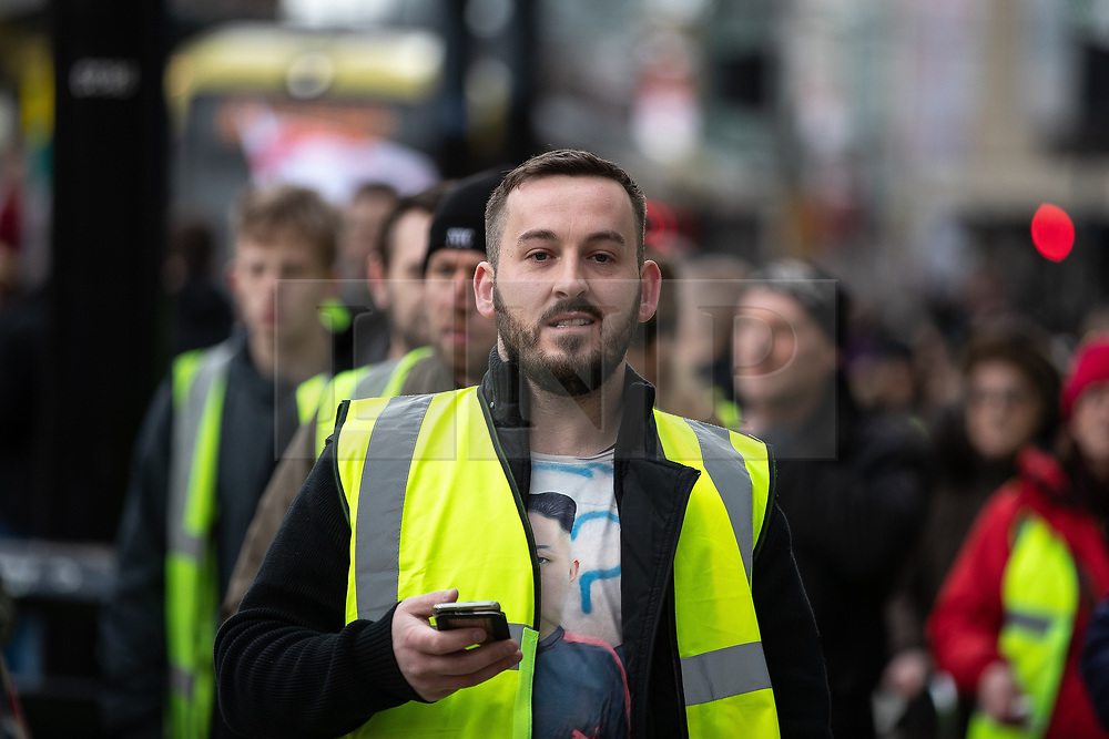 """© Licensed to London News Pictures . 09/02/2019. Manchester , UK . JAMES GODDARD leads a """" Yellow Vest """" protest in Manchester City Centre . The yellow vest concept has been adopted from French demonstrators by some British groups in support of Brexit , Donald Trump and former EDL leader Stephen Yaxley-Lennon - aka Tommy Robinson . A similar demonstration in the city in January was ridiculed after protesters were kettled by police in front of a branch of Greggs the Baker . Photo credit : Joel Goodman/LNP"""