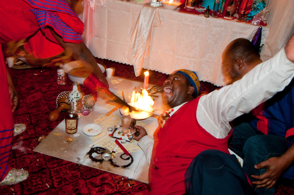 Vodou ceremony during the winter solstice in a suburbs of Montreal.The mambo is possess by the war spirit call by the fire.