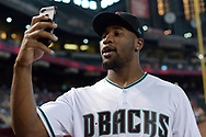 PHOENIX, AZ - JUNE 23:  Haason Reddick of the Arizona Cardinals on a cellphone prior to the MLB game between the Philadelphia Phillies and Arizona Diamondbacks at Chase Field on June 23, 2017 in Phoenix, Arizona.  Reddick is the Arizona Cardinals 2017 first-round draft pick. (Photo by Jennifer Stewart/Getty Images)