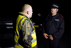 © Licensed to London News Pictures. 03/09/2013. Eldersfield, Gloucestershire, UK. Terry Howard from We Are Change Gloucestershire talks to police.  Around 100 people from the Wounded Badger Patrol patrol in Gloucestershire patrolled local roads and public footpaths looking for injured badgers from the badger cull which has now started in West Gloucestershire.  Police were also patrolling but there were no arrests.  03 September 2013.<br /> Photo credit : Simon Chapman/LNP