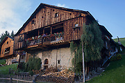 Wide architecture of a typical Tyrolean barn in Pransasores, a Dolomites hamlet in south Tyrol, Italy.