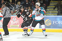 KELOWNA, CANADA, FEBRUARY 17: Brady Brassart #27 of the Calgary Hitmen is checked by Madison Bowey #4 of the Kelowna Rockets at the Kelowna Rockets on February 17, 2012 at Prospera Place in Kelowna, British Columbia, Canada (Photo by Marissa Baecker/Shoot the Breeze) *** Local Caption ***