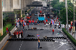 Anti-government protester builds up blockades as they prepare to face-off Thai army during pitched battles on the streets of Bangkok, Thailand, 13 April 2009. Thai Prime Minister Abhisit Vejjajiva declared a state of emergency in Bangkok to quell anti-government protests that forced the cancellation of the ASEAN summit in Pattaya. Thai soldiers fired shots at protestors driving buses at them and used tear gas against demonstrators blocking a main road junction in Bangkok in a major escalation of political violence in the kingdom