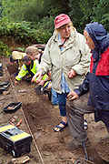 SAVEOCK WATER, CORNWALL, ENGLAND - AUGUST 03: A close up of archaeologist Jacqui Wood, her team and students on August 3, 2008 in Saveock Water, Cornwall. They are excavating a Mesolithic platform. (Photo by Manuel Cohen)