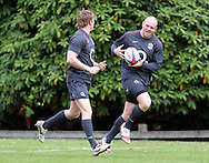 © Andrew Fosker / Seconds Left Images 2010 - Mike Tindall (R) receives a pass from David Strettle  -  England Rugby Training - Pennyhill Park Hotel - 02/11/10 - Bagshot - UK - All Rights Reserved