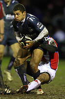 Photo: Rich Eaton.<br /> <br /> Sale Sharks v Bristol Rugby. Guinness Premiership. 01/01/2007. Jason Robinson of Sale is tackled by Bristols David Lemi