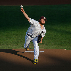 Jun 24, 2013; Omaha, NE, USA; Mississippi State Bulldogs starting pitcher Trevor Fitts (31) delivers a pitch during the first inning in game 1 of the College World Series finals against the UCLA Bruins at TD Ameritrade Park. Mandatory Credit: Derick E. Hingle-USA TODAY Sports