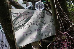 A sign at the Stop HS2 Wendover Active Resistance Camp is seen on 17th July 2020 in Wendover, United Kingdom. Environmental activists from groups including Stop HS2 and HS2 Rebellion continue to protest against HS2, which is currently projected to cost £106bn and which will remain a net contributor to CO2 emissions during its projected 120-year lifespan, on environmental and economic grounds.