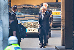 © Licensed to London News Pictures. 25/07/2019. London, UK. Prime Minister Boris Johnson asks his team for the correct door to enter as he arrives at Parliament with Sir Edward Lister his Chief of staff. The Conservative Party has elected Boris Johnson as their new leader and Prime Minister, following Theresa May's resignation. Photo credit: Peter Macdiarmid/LNP