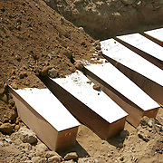 29th July 2006&amp;#xD;&amp;#xA;Tyre, Lebanon&amp;#xD;&amp;#xA;Mass Burial in Tyre&amp;#xD;&amp;#xA;On 29th July 2006 Lebanese medical and military personel prepared the bodies and coffins beofre burying more than 30 people killed by Israeli bombardment in a mass grave.<br />
