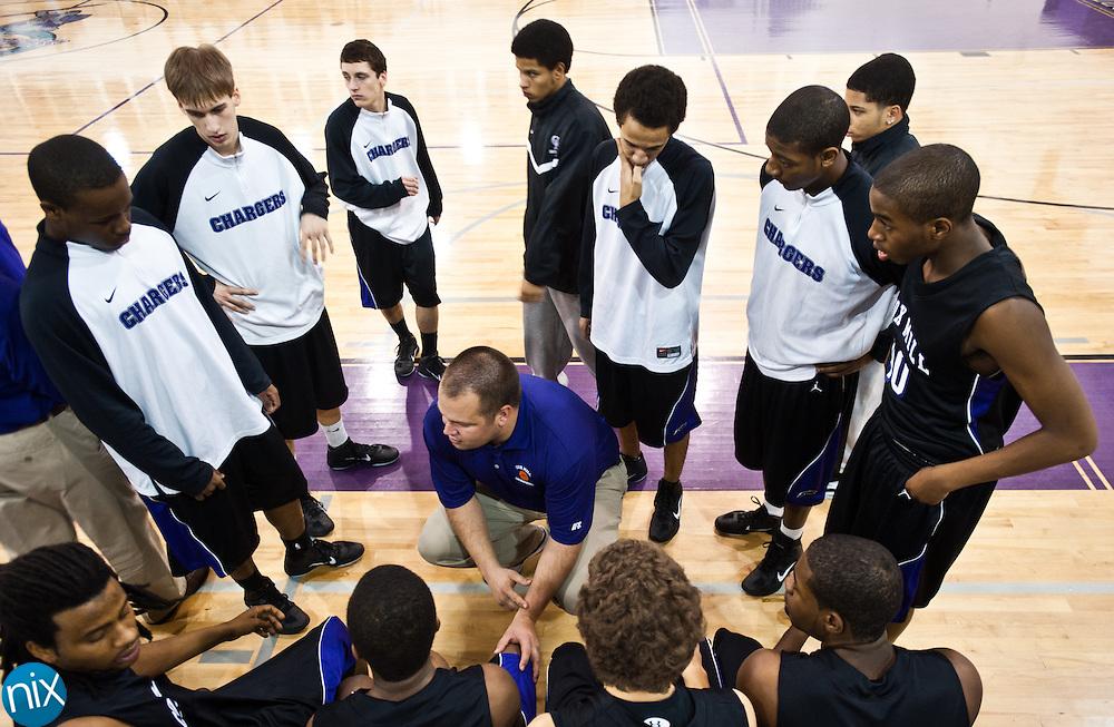 Cox Mill head coach Brad Hinson talks with is players during a semi-final matchup of the CMC-Northeast Holiday Basketball Tournament at Cox Mill High School Wednesday night. Central won the game 66-41. (Photo by James Nix)