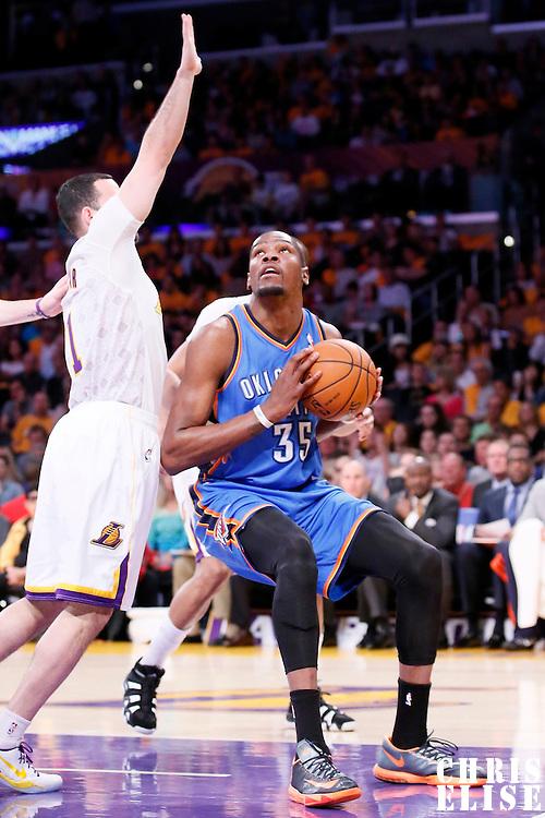 09 March 2014: Oklahoma City Thunder small forward Kevin Durant (35) drives past Los Angeles Lakers point guard Jordan Farmar (1) during the Los Angeles Lakers 114-110 victory over the Oklahoma City Thunder at the Staples Center, Los Angeles, California, USA.