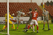 Christian Burgess of Portsmouth heads the ball down for John Marquis of Portsmouth  to score during the EFL Trophy match between Walsall and Portsmouth at the Banks's Stadium, Walsall, England on 7 January 2020.