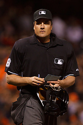 June 21, 2011; San Francisco, CA, USA;  MLB umpire Mike DiMuro (16) stands behind home plate during the eighth inning between the San Francisco Giants and the Minnesota Twins at AT&T Park. Minnesota defeated San Francisco 9-2.