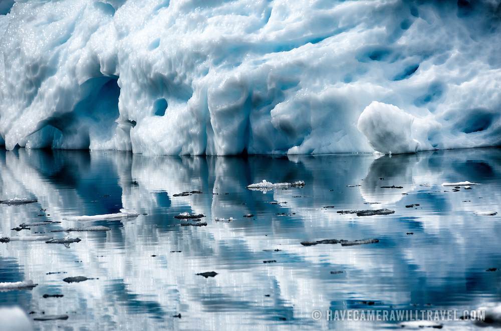 Part of an iceberg is reflected in still waters at Cuverville Island in Antarctica.