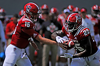 Wolfpack quarterback Ryan Finley (15) hands off to running back Reggie Gallaspy (25) against JMU.