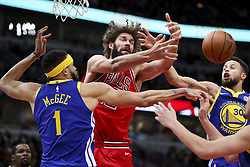 January 17, 2018 - Chicago, IL, USA - Golden State Warriors center JaVale McGee (1) and guard Stephen Curry (30) go up for a rebound against Chicago Bulls center Robin Lopez (42) during the first half at the United Center in Chicago on Wednesday, Jan. 17, 2018. The Warriors won, 119-112. (Credit Image: © Armando L. Sanchez/TNS via ZUMA Wire)