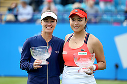 Switzerland's Martina Hingis (left) and Chinese Taipei's Yung-jan Chan (right) celebrate with their trophies after winning against Australia's Ashleigh Barty and Casey Dellacqua in the Women's Doubles Final during day nine of the AEGON International at Devonshire Park, Eastbourne.