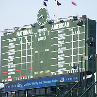 Wrigley Field scoreboard sign. Wrigley Field is home to the Chicago Cubs baseball team and is one of the oldest ballparks in the United States.