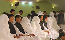 60354095<br /> Couples attend a mass charity wedding ceremony in Balkh province, northern Afghanistan, on August 13, 2013. Charities organised the mass wedding for some 52 couples to help who are unable to afford individual ceremonies.<br /> Balkh province, northern Afghanistan, Wednesday August 13, 2013.<br /> Picture by imago / i-Images<br /> UK ONLY
