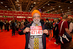© Licensed to London News Pictures.22/04/2015<br /> LONDON UK: Malik Singh (70) a veteran runner collects his numbers on the opening  day of registration of the 2015 Virgin Money London Marathon at the Excel Centre London.Photo credit : Andrew Baker/LNP
