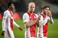 18-12-2016: Voetbal: Ajax v PSV: Amsterdam<br /> <br /> (L-R) Ajax speler Davy Klaassen bedankt het thuispubliek na afloop van het Eredivisie duel tussen Ajax en PSV op 18 december in De Arena tijdens speelronde 17<br /> <br /> Eredivisie - Seizoen 2016 / 2017<br /> <br /> Foto: Gertjan Kooij