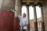"ROME, ITALY - 30 MARCH 2015: A maintenance worker employed at Cinecittà Studios paints a Roman temple of the set of ""Rome"", the British-American-Italian broadcasted between 2005 and 2007 on HBO, BBC Two and RaiDue, here in Cinecittà, Rome, Italy, on March 30th 2015.<br /> <br /> Italy instated a special 25% tax credit for film productions in 2010. The industry then lobbied to remove the credit's cap, and last July, Italy lifted its tax credit limit from €5 million per movie to €10 million per company per year. <br />  <br /> Cinecittà, a large film studio in Rome, is considered the hub of Italian cinema. The studios were founded in 1937 by Benito Mussolini as part of a scheme to revive the Italian film industry. In the 1950s, the number of international productions being made here led to Rome being dubbed as the ""Hollywood on the Tiber"". In the 1950s, Cinecittà was the filming location for several large American film productions like Ben-Hur, and then became the studio most closely associated with Federico Fellini.<br /> After a period of near-bankruptcy, the Italian Government privatized Cinecittà in 1997, selling an 80% stake.<br /> <br /> Currently Ben-Hur and Zoolander 2 are booked into Cinecittà Studios."