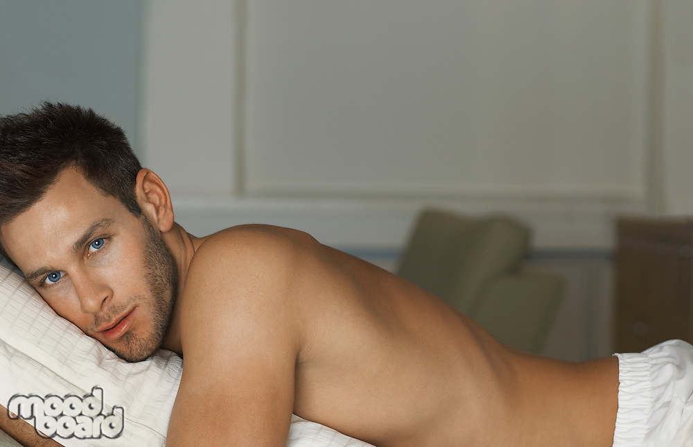 Shirtless Man Hugging Pillow