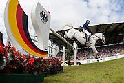 Daniel Deusser - Cornet d' Amour<br /> World Equestrian Festival, CHIO Aachen 2013<br /> © DigiShots