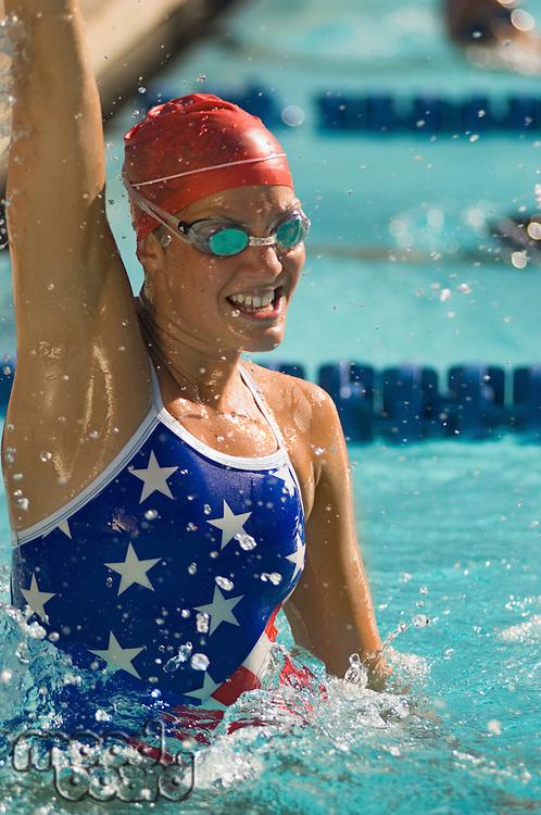 Female swimmer celebrating victory in pool
