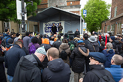 Southall, UK. 27th April 2019. Akram Salhab, Palestinian organiser and campaigner for migrant and refugee rights, addresses members of the local community and supporters at a rally outside Southall Town Hall to honour the memories of Gurdip Singh Chaggar and Blair Peach on the 40th anniversary of their deaths. Gurdip Singh Chaggar, a young Asian boy, was the victim of a racially motivated attack whilst Blair Peach, a teacher, was killed by the Metropolitan Police's Special Patrol Group during a peaceful march against a National Front demonstration.