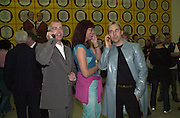 Neil Tennant, Janet Street-Porter and David Furnish phoning up the numbers given in Gilbert and George's sex ads. New Horny pictures. Gilbert and George. White Cube, Hoxton Sq. London 1 June 2001. © Copyright Photograph by Dafydd Jones 66 Stockwell Park Rd. London SW9 0DA Tel 020 7733 0108 www.dafjones.com