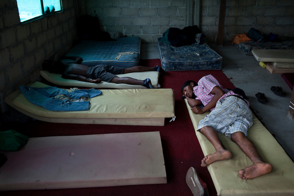 Oscar Suazo(back left) and Andres Sanchez sleep in a migrant shelter in Tenosique, Tabasco.  The two men are cousins from Honduras and are planning to ride a freight train north to the border with the United States.  The trip for these migrants, mostly from Central America,  has become increasingly dangerous over the past several years as Mexico's drug war has raged and kidnappings and killings of migrants has increased.