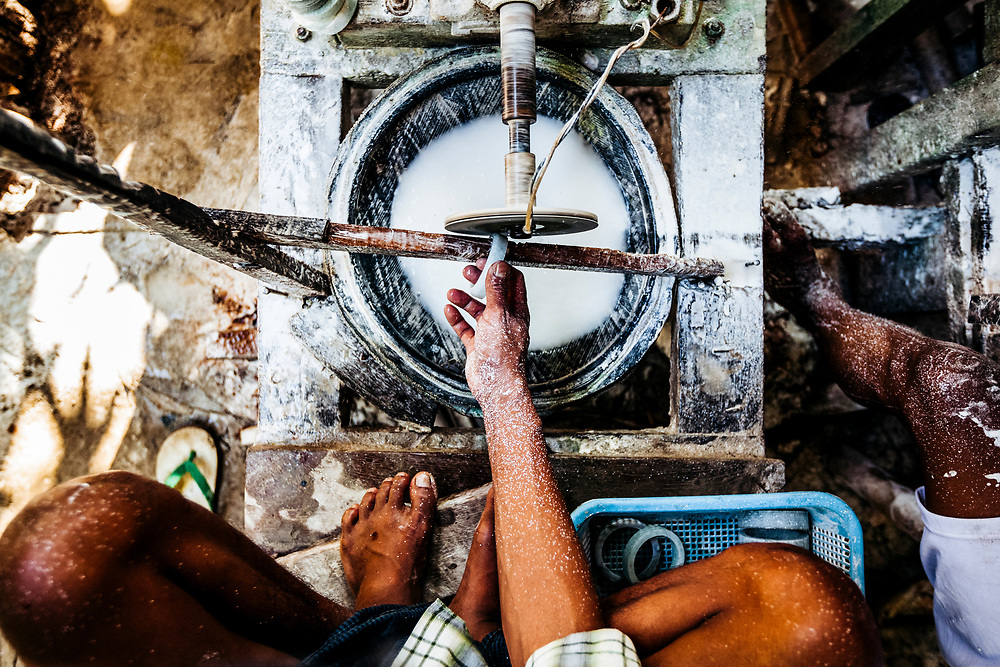 A Burmese man polishes a jade bracelet at a small factory in outer Mandalay, Myanmar.