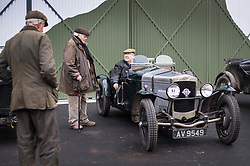 © Licensed to London News Pictures. 28/01/2018. Weybridge, UK. Visitors to Brooklands Museum admire a 1928 Frazer Nash Super Sports car as members of The Vintage Sports-Car Club take part in New Year driving tests round the historic motor racing circuit. Photo credit: Peter Macdiarmid/LNP