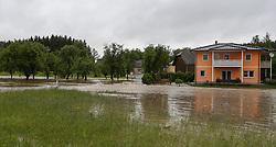 02.06.2013, Ager, Timelkam, AUT, Timelkam starke Regenfaelle, im Bild Zufahrtsstrasse nach Jochling ueberschwemmt. Starkregen sorgt derzeit vor allem in Tirol, Oberoesterreich und Salzburg für massive Überflutungen, Vermurungen und Hangrutsche // Heavy rain is currently making, especially in Tyrol, Upper Austria and Salzburg for massive flooding, mudslides and landslides, Timelkam, Austria on 2013/06/02. EXPA Pictures © 2013, PhotoCredit: EXPA/ Roland Hackl