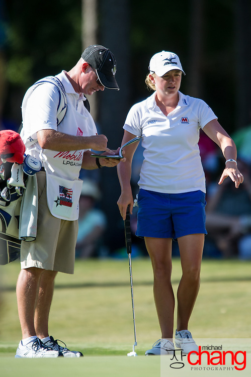 April 29 2012: Stacy Lewis analyzes the green with her caddy on the 18th hole during the final round of the Mobile Bay LPGA Classic at Magnolia Grove in Mobile, AL.