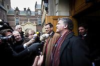 Nederland. Den Haag, 13 januari 2010.<br /> Rouvoet en Bos verlaten het ministerie van Algemene Zaken na overleg met premier Balkenende, daags na de presentatie van het rapport van de commissie Davids. De PvdA is erg ongelukkig met de wijze waarop Balkenende gisteren vragen beantwoordde op de persconferentie. Een breuk in de coalitie dreigt. Coalitie, Balkenende IV, vierde kabinet Balkenende<br /> Foto Martijn Beekman