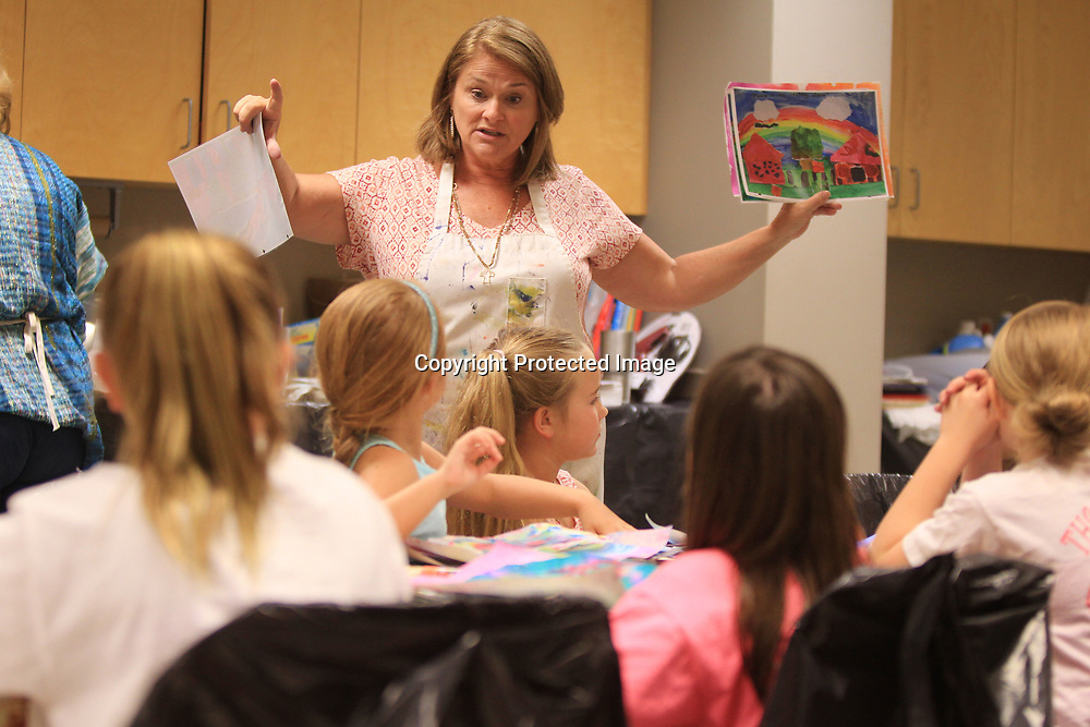 Gena Yarbrough, the Lee County Schools Art Curriculm Coordinator, gives out a lesson where the students are to make a home out of their work and encouraging them to be as creative as possible during the process during Ole Miss-Tupelo Summer Art Camp on the Tupelo campus.